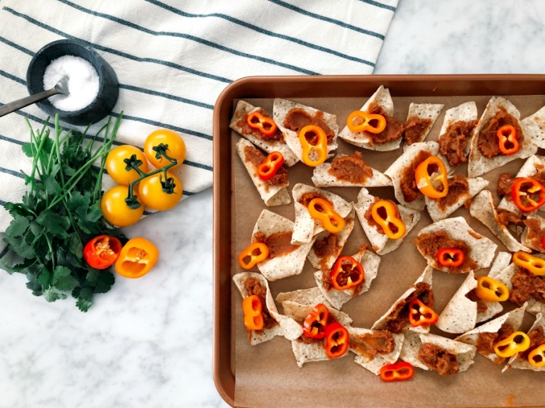 Grain-free sheet pan nachos! Takes just 10 minutes in the oven! Vegetarian + healthier without losing the flavor!