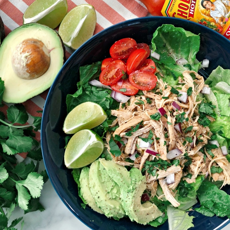 Quick, versatile and and delicious Paleo Instant Pot Shredded Chicken Taco Bowls from frozen meat! Dinner to the table in 20 minutes!