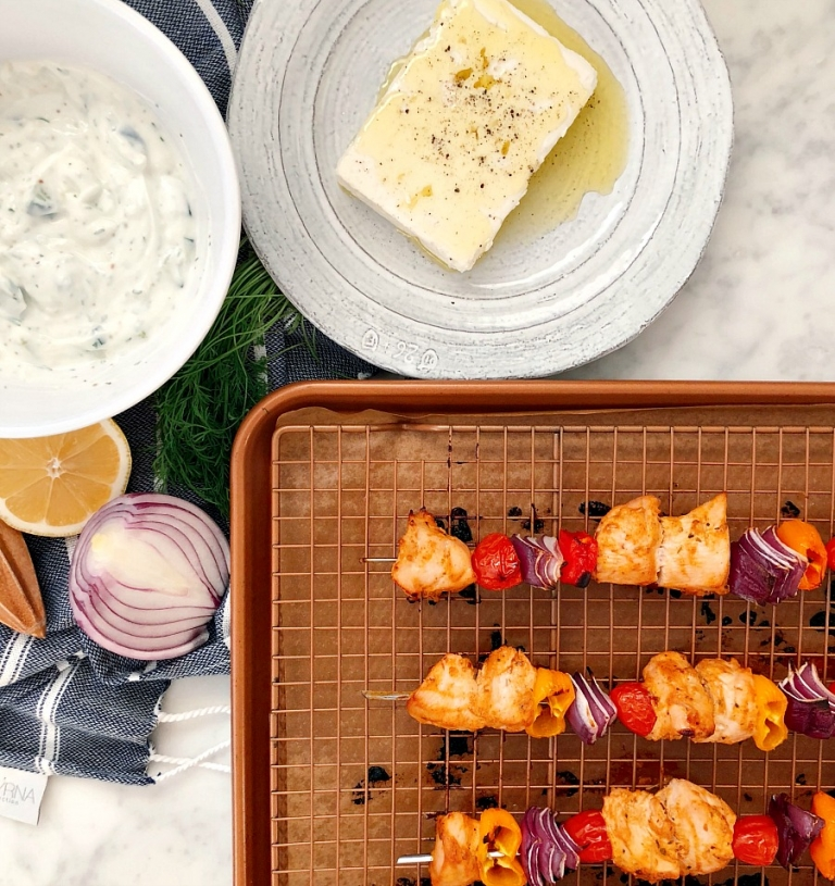 Easy, delicious weeknight meal! These gluten-free chicken kabobs are flavorful and juicy! Served with fresh, homemade tzatziki sauce!