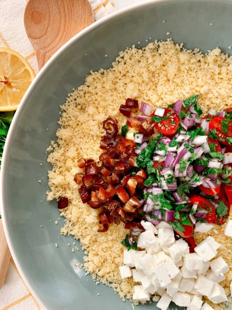 A must have side dish for your Mediterranean meal! This Mediterranean Couscous recipe is flavorful and light! Bursting with fresh mint, tangy feta and dates for a touch of sweetness!