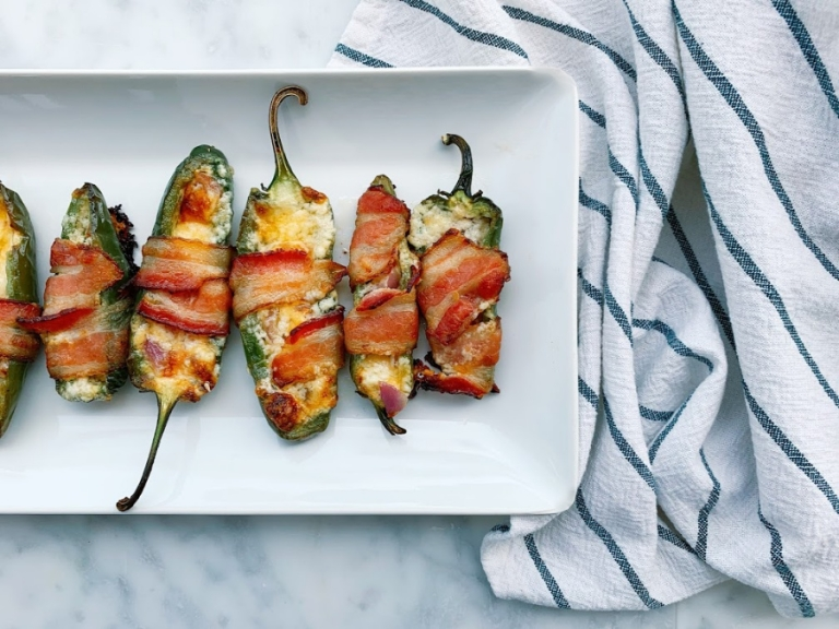 These mouthwatering bacon wrapped jalapeños are cheesy, gooey, crispy and unforgettable. Stuffed with creamy mascarpone cheese, sharp cheddar cheese and garlic! Perfect for any gathering!