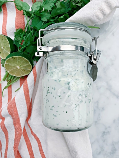 The best summer sauce! This Cilantro Yogurt Sauce has so much flavor with the freshness of cilantro and the bright flavors of fresh squeezed lime juice. Perfect for rice bowls, tacos, and salads!
