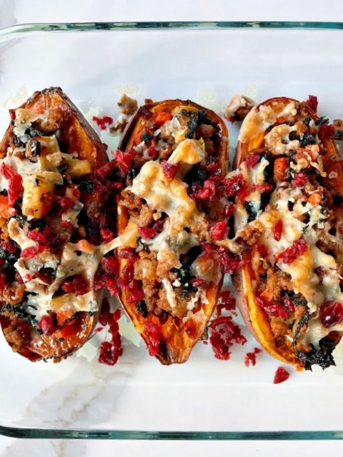 Stuffed sweet potatoes with parmesan cheese and dried cranberries.