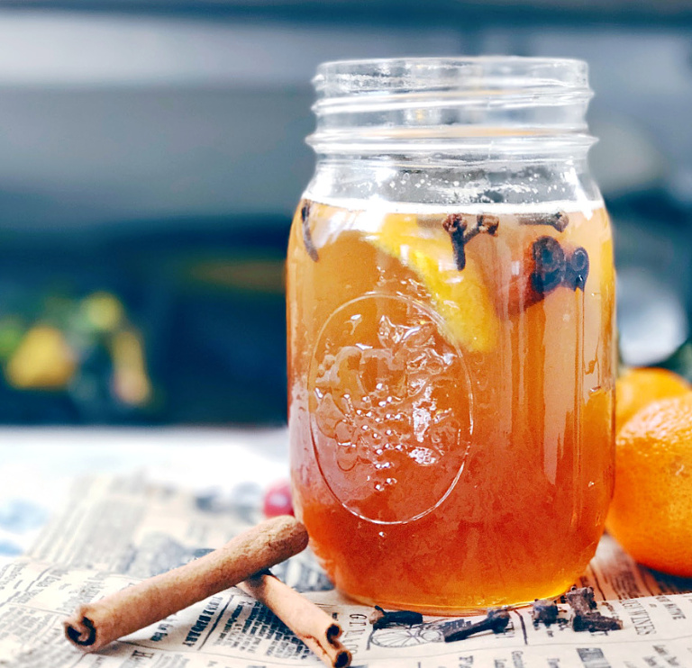 homemade honey simple syrup with orange peel and clove.