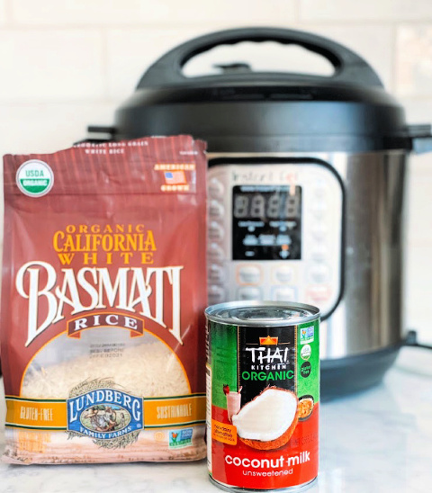 Coconut rice in the Instant Pot comes together in less than 60 seconds and cooks in 7 minutes! Perfect to serve with stir fry recipes, curries, or with fresh mango!