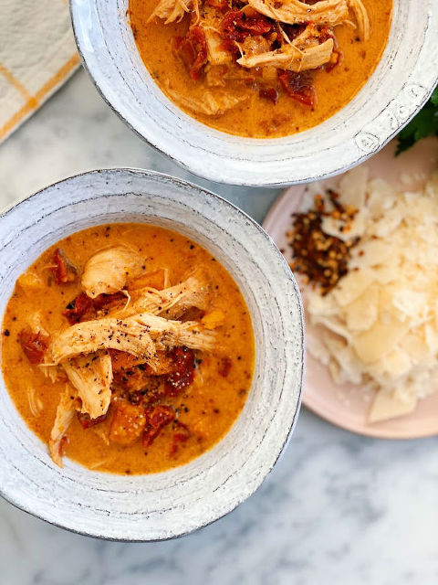 Chicken and Sun-dried Tomato Soup! This soup tastes like PIZZA! Bursting with flavor, real ingredients! And it comes together in under 20 minutes!